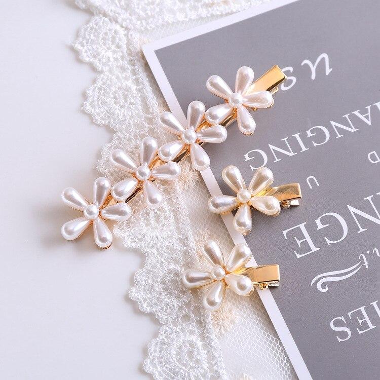 Nueva flor de perla a la moda clip de pico de pato Flor de moda coreana horquilla lateral chuck corte de pelo flequillo clip wild Headwear Accesorios