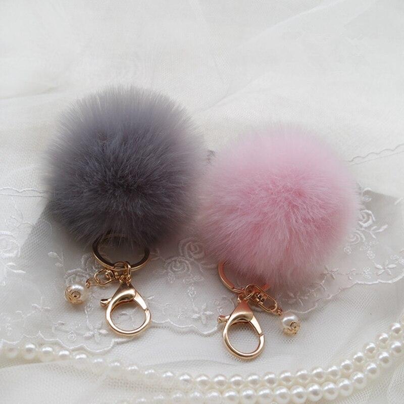 Moda mullido pompón Bola de pelo de conejo llavero con pompón perla llavero mujeres bolso encanto trinquete oro coche llavero joyería regalo