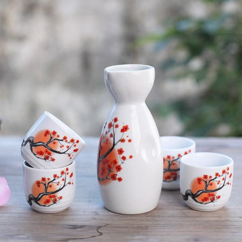 Sake japonés con cuatro tazas pintado a mano cártamo porcelana estilo cerámica tradicional artesanías vino taza olla