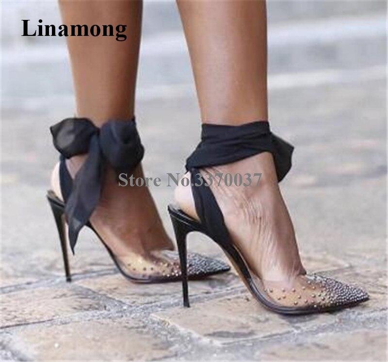 Zapatos de tacón de aguja con diamantes de imitación, de PVC, puntiagudos, de diseño de marca para mujer, con tiras cruzadas de encaje en negro, rojo, blanco y cristal, tacones altos