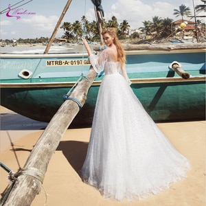 Waulizane Simple Puffy A Line Wedding Dress Beach Full Sleeve Of Scoop Neckline Wedding Gown Full With Pearls
