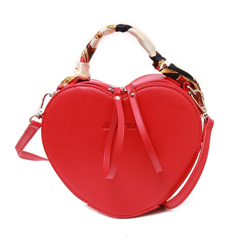 Bolso de mano para mujer, con forma de corazón, de piel sintética, de Color liso, para mujer, bandolera, bolsos de mano a la moda para mujer, bolso de mano de piel famou