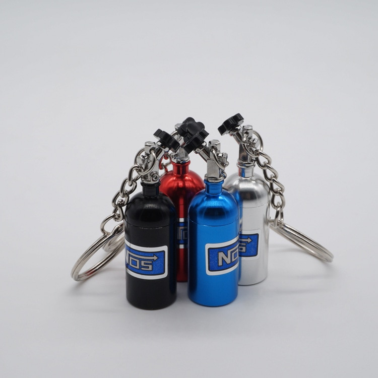 DHL 100 Uds Turbo llavero Mini óxido nitroso botella llavero Almacenamiento de caja de pastillas
