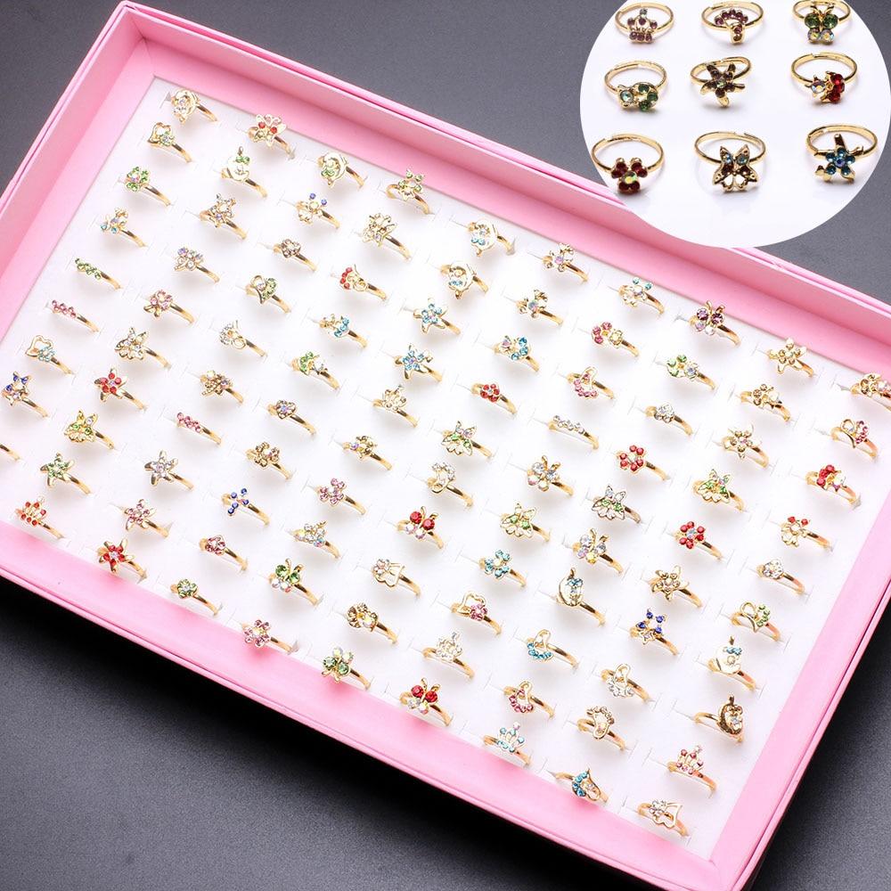Atacado misturado 100 pçs sortidas dos desenhos animados de cristal anéis ajustáveis crianças meninas mix estilos anel festa presente jóias com caixa exibição