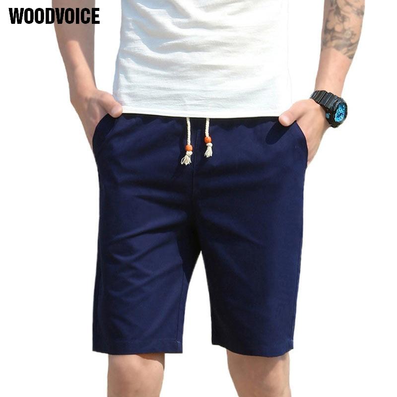 Ropa de marca cintura elástica novedad de verano Pantalones cortos casuales hombres algodón Sim ajuste Color sólido disponible longitud de rodilla pantalones cortos de alta calidad