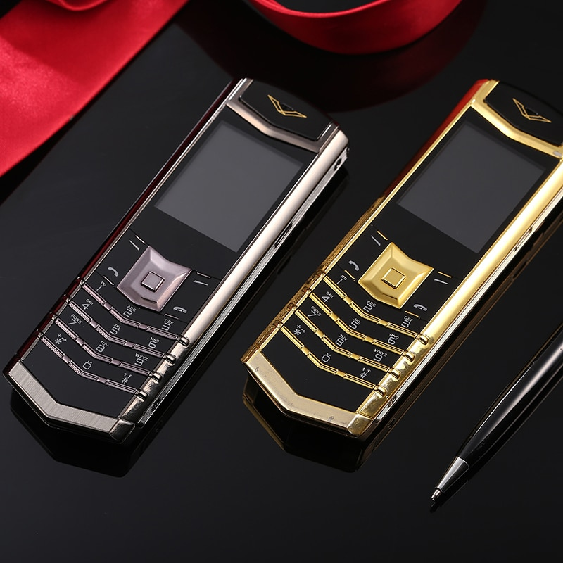 Larga modo de reposo de teléfono de barra rusa de lujo GSM bluetooth mp3 mp4 FM radio de acero inoxidable cuerpo de metal Quad band teléfono móvil M6i