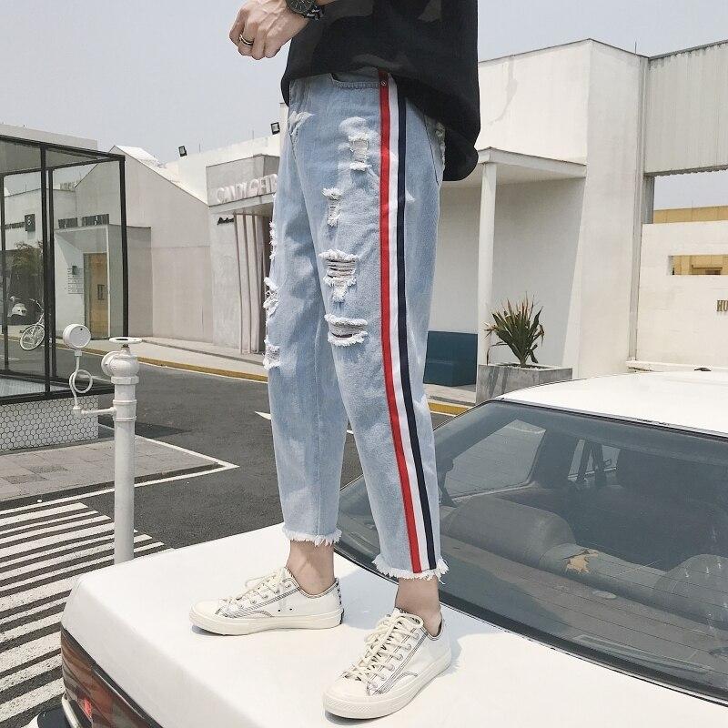 2018 moda para hombre estilo clásico tejido elástico azul con agujeros decorados pantalones vaqueros informales pantalones vaqueros de motociclista pantalones vaqueros talla S-2XL