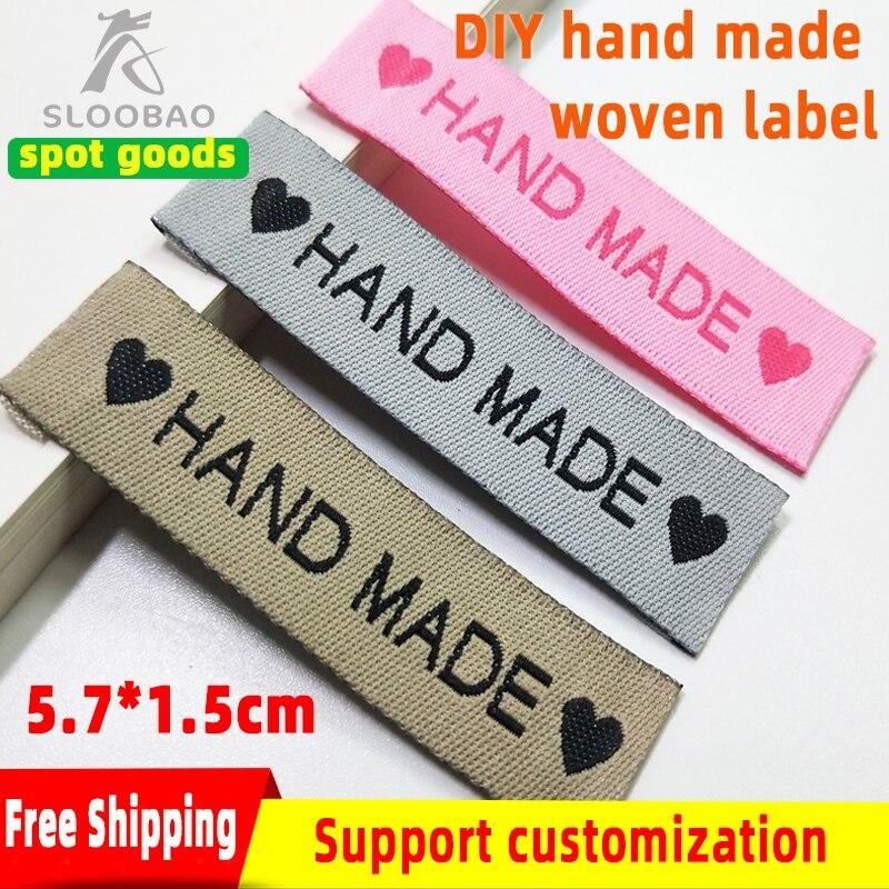 Envío Gratis etiqueta de tela hecha a mano corazón coser en ropa etiquetas de ropa 60x15mm DIY etiquetas tejidas