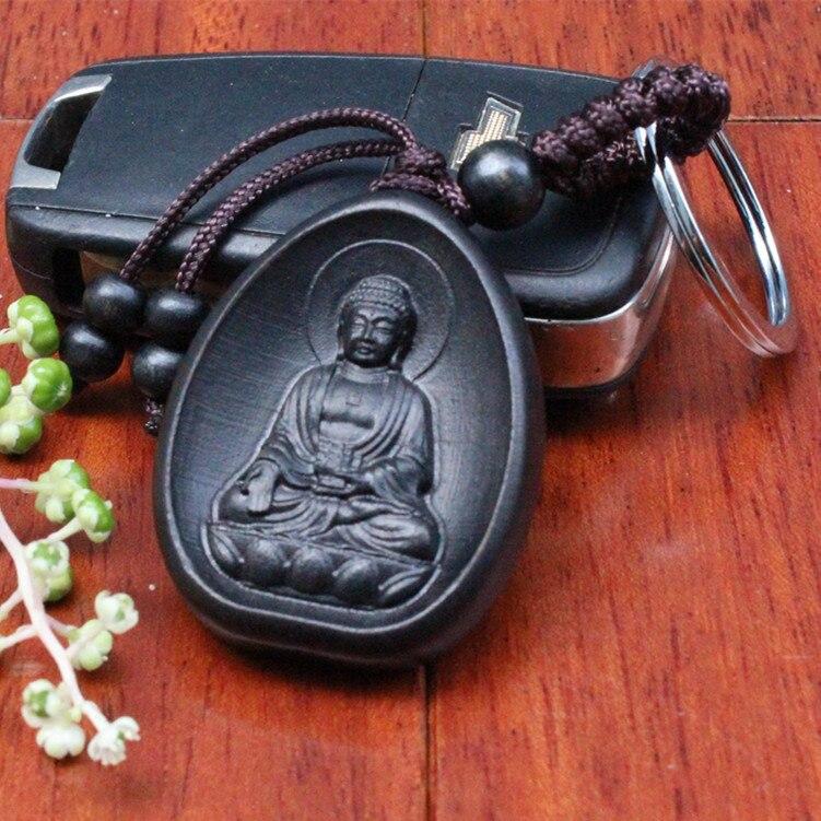 Llaveros creativo coche personalizado colgante de anillos de llave de madera de moda negro Amitabha Buddha talla en palo de rosa budista llavero titular