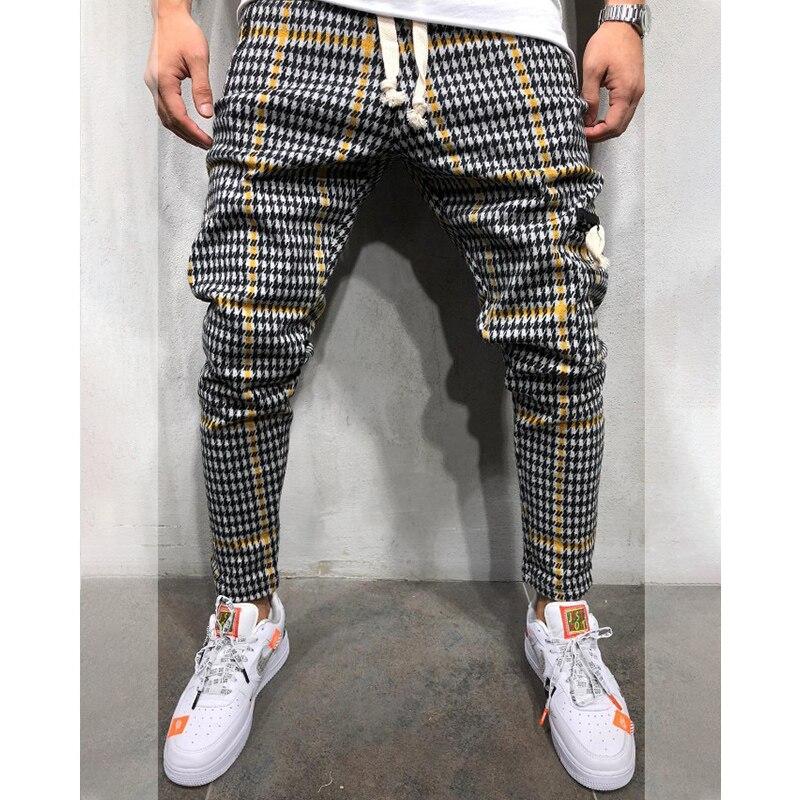 Pantalones a rayas deportivos casuales delgados para hombres Streetwear Plaid Jogger Fitness cordón elástico Hip Hop pantalones culturismo bolsillos
