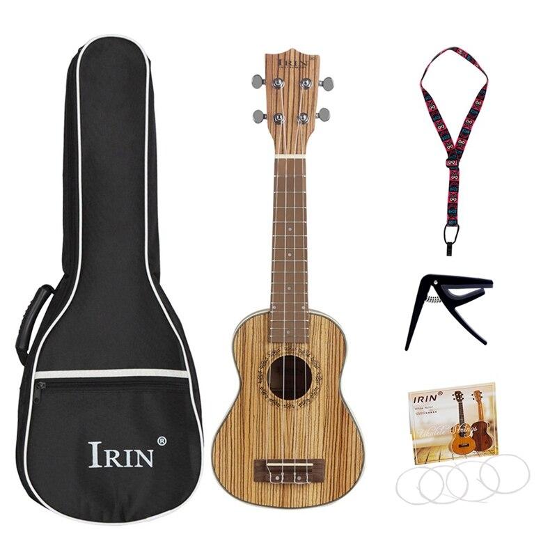 HOT-Irin High Grade Ukulele Kits Zebra Wood 4 Strings Hawaiian Mini Guitar Uke Bag String Capo Strap
