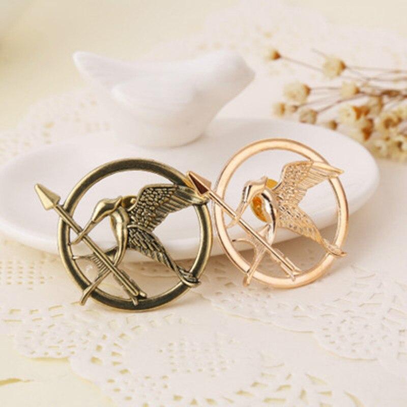 1 Uds. Película de joyería de moda los juegos del hambre animales pájaros broches insignia para mujer hombre mochila, ropa icono broche Pins
