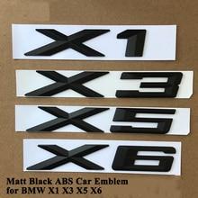 1 pc ABS Matt Black Car Emblema Logo Distintivo Tronco di Coda Accessori Sticker per BMW X1 E84 F48 X3 F25 g01 X5 E70 F15 X6 F16 E71 G06