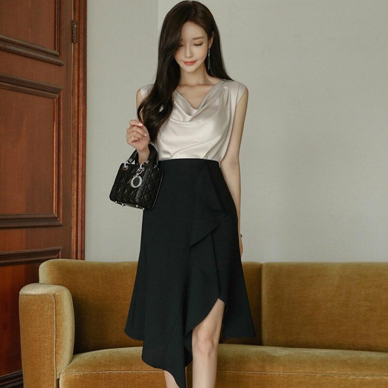 الصيف بلا أكمام قمة صلب غير النظامية تنورة سوداء قطعتين الركبة طول مجموعات مثير مناسبة فستان الحفلات