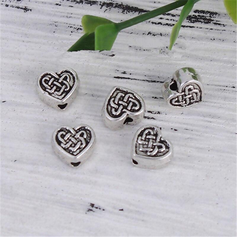 """DoreenBeads cuentas separadoras de aleación a base de Zinc corazón color plata nudo chino 7mm (2/8 """") x 7mm (2/8""""), agujero: aprox. 1,8mm, 20 Uds."""