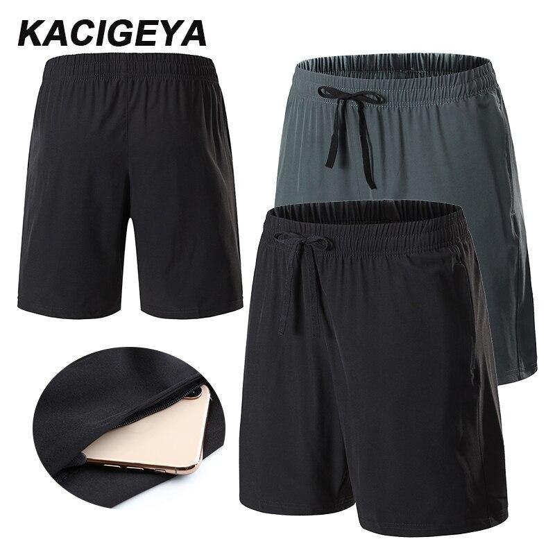 Corriendo pantalones cortos de baloncesto hombre Fitness transpirable de fútbol entrenamiento pantalones cortos sueltos tirar bolsillo Pantalones deportivos para hombre