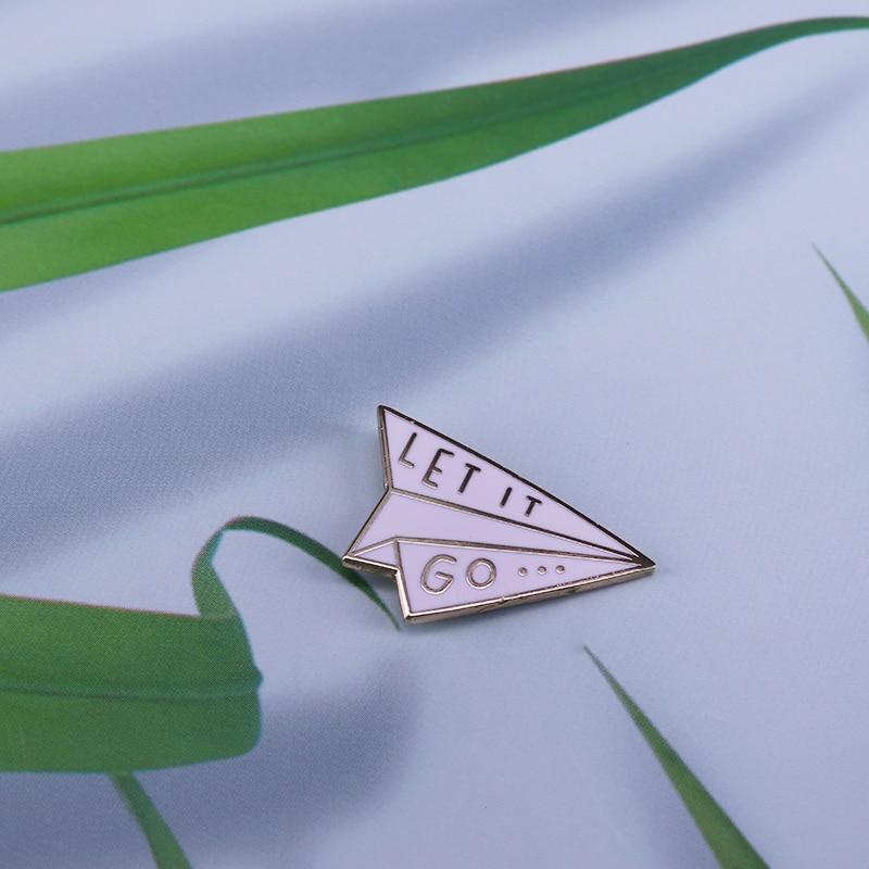 Laisser aller broche en émail avion Origami