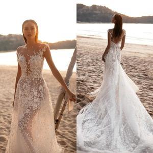 Sheer Cap Sleeve Beach Mermaid Wedding Dress with Long Train Lace Appliqued Tulle Boho Wedding Gowns Backless Vestido De Novia