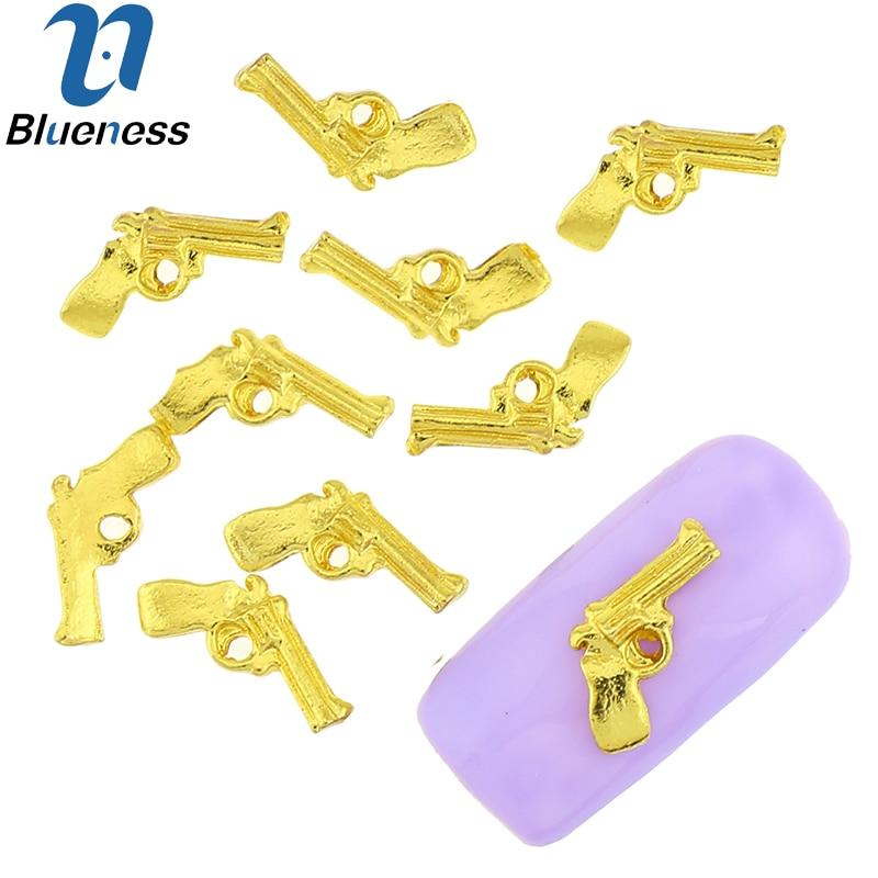 10 Unids/lote Encantos Pistola Diseño 3D Arte Del Clavo Del Brillo Decoraciones de la Aleación de Oro Espárragos DIY Suministros de Manicura Accesorios TN1796