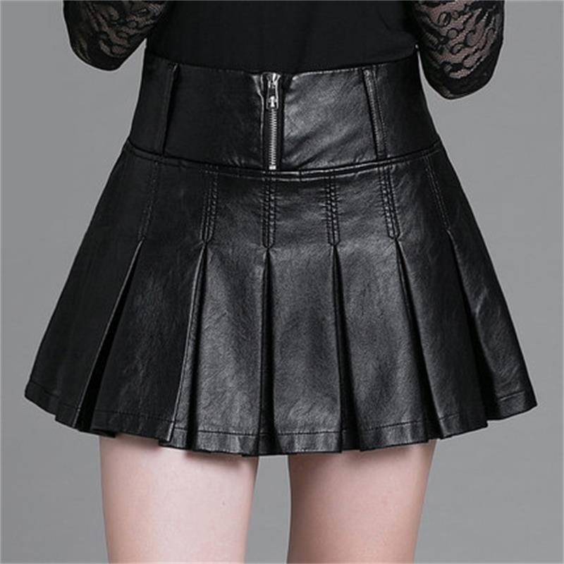 Jupe courte grande taille femmes jupe version coréenne couture cuir synthétique jupe plissée automne et hiver jupe basse