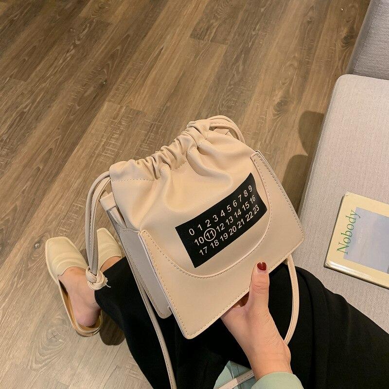 Bolso de mujer 2019 nuevo tipo pequeño fresco bombeo barril bolsa de moda un hombro inclinado bolsa