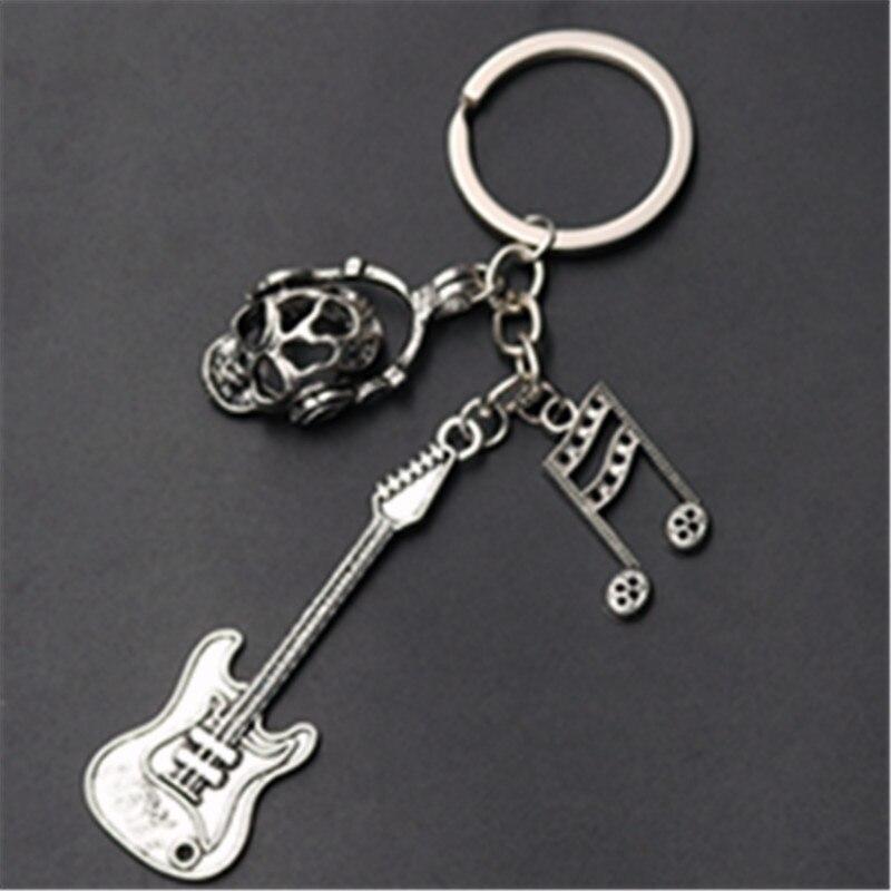 1 pçs banhado a prata * crânios fone de ouvido * guitarras elétricas * nota musical * glamour liga chaveiros diy metal artesanal jóias a1037