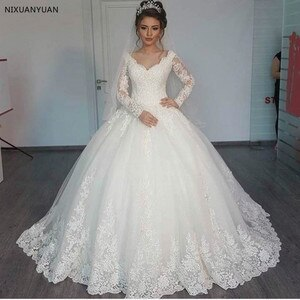 Gorgeous Sheer White Wedding Dresses 2021 Puffy Lace Beaded Applique Long Sleeve Arab Wedding Gowns