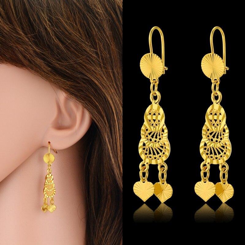 Moderno pendiente colgante de corazón hueco dorado para mujer, pendiente dorado para mujer, joyería para fiesta y boda, regalo oorbellen
