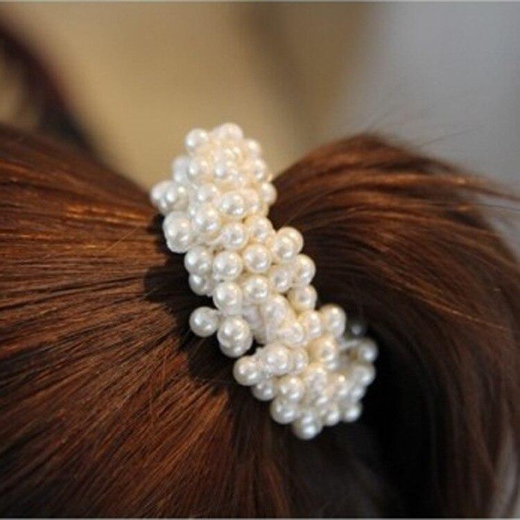 Nuevo Producto creativo, anillo de pelo de perlas para niñas, cuerda de pelo coreana con flor, anillo de pelo importado, banda para la cabeza de goma, cuerda al por mayor