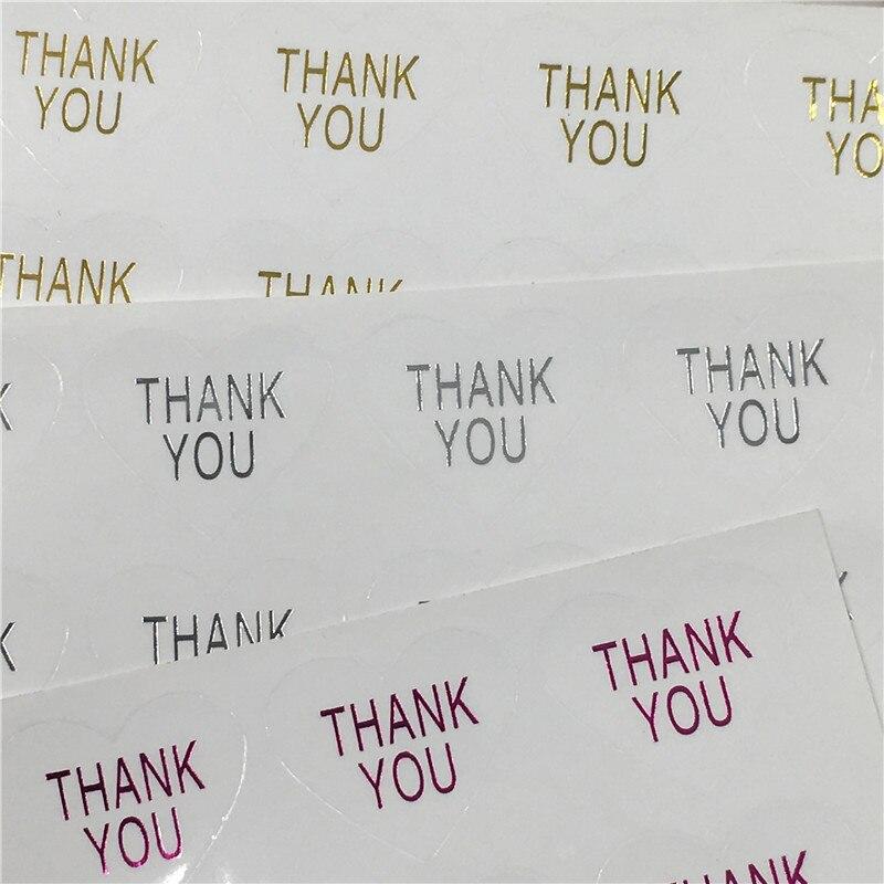 100 piezas transparente con forma de corazón impreso a mano y gracias por el color de la fuente sellada etiqueta de embalaje