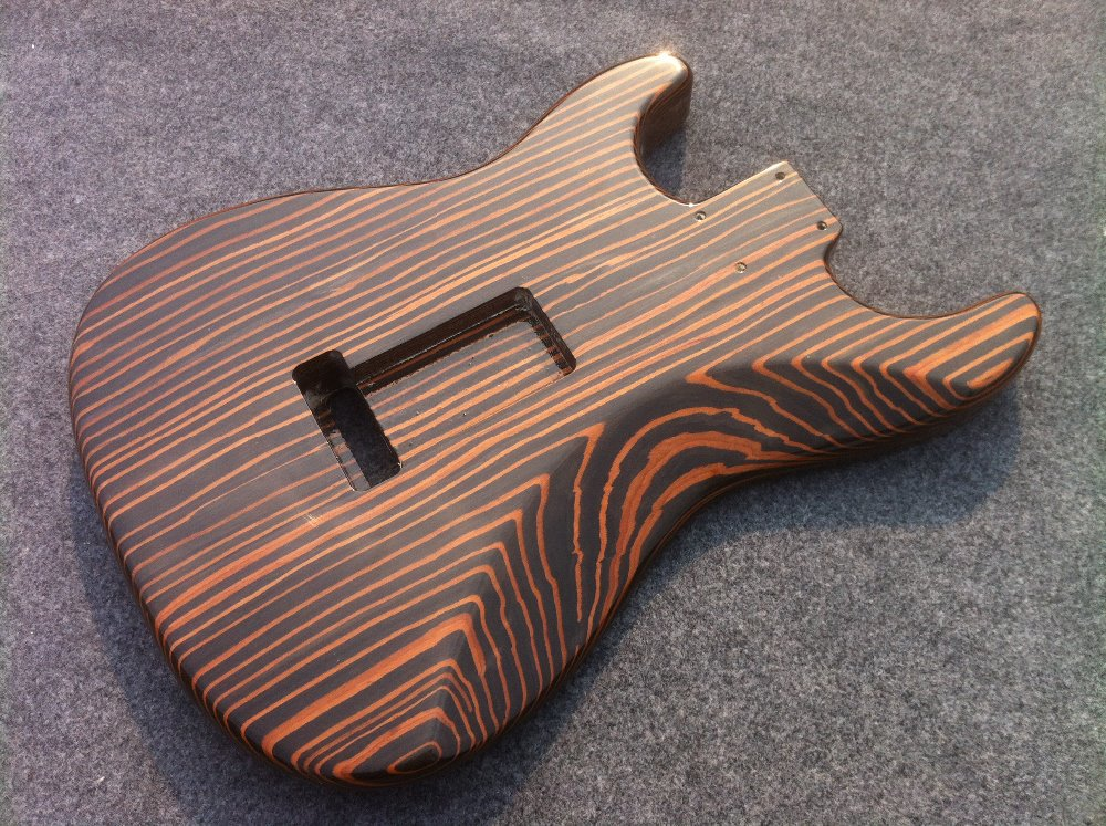 Free shipping  one piece Zebrawood body  electric guitar  body have more color can choose enlarge