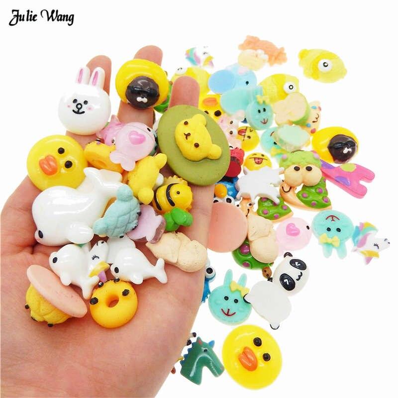 Estuche para teléfono con cabujón plano con dijes de animales de dibujos animados al azar de resina de 20 piezas