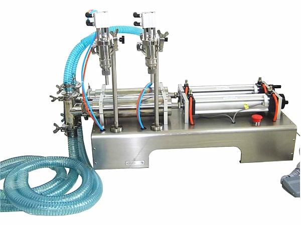Petite machine de remplissage liquide pneumatique dacier inoxydable de 30-300 ml, machine de remplissage liquide de fioles