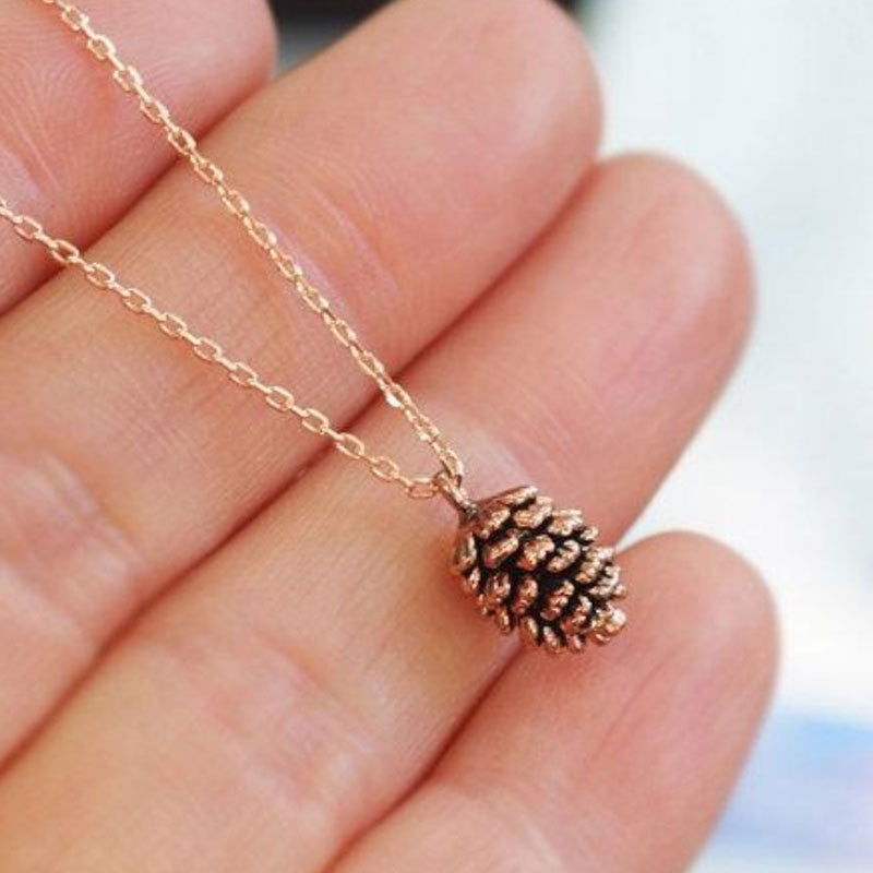 Timlee N031 envío gratis, nuevo collar con colgante de muestra de planta de piñones simples, joyería de moda al por mayor
