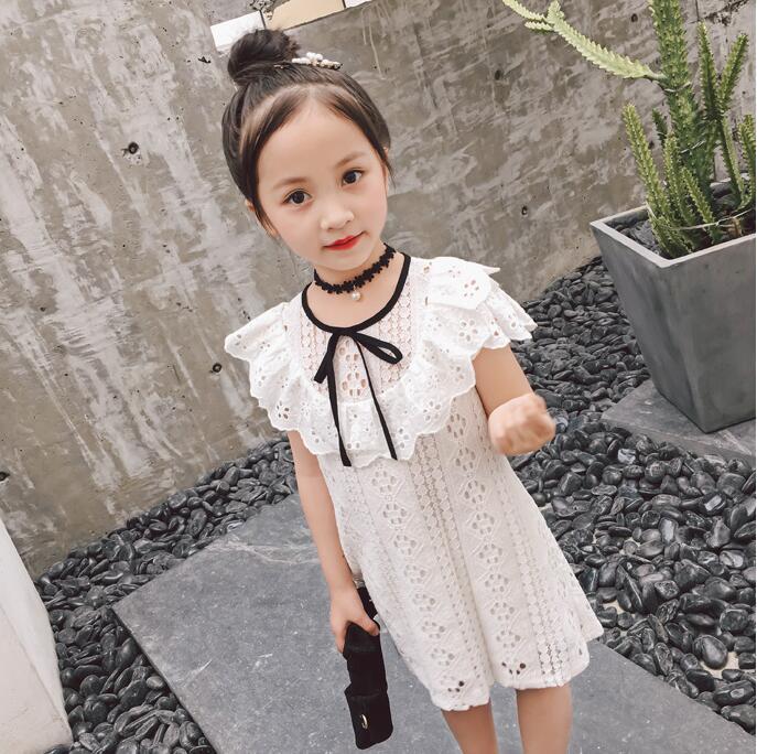 Vestido de encaje para niñas 2018 verano sin mangas flor pantalla hilo hueco chica dulce vestido de princesa esponjoso marea