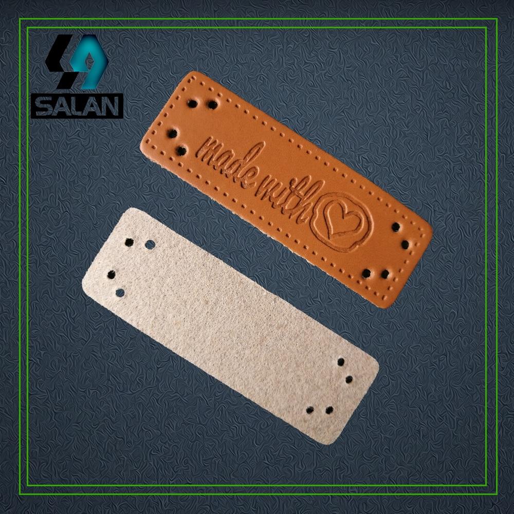 Venta al por mayor de hecho con corazón etiquetas de cuero de coser de cuero etiquetas de decoración hecho a mano personalizado etiquetas ropa