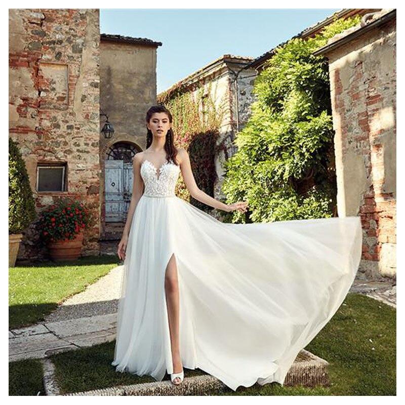 Купить с кэшбэком LORIE Boho Wedding Dress 2019 Appliqued Sexy See Through Neck Tulle A-Line Sexy Backless Beach Bride Dress  Sexy Wedding Gown