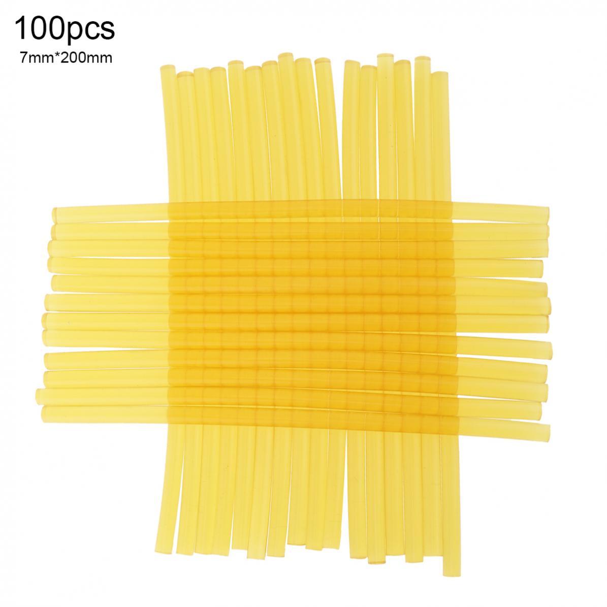 100 unids/lote 7mm x 200mm amarillo fuerte viscosa pistola de fusión en caliente barras de pegamento herramientas de protección del medio ambiente para pistola de pegamento de fusión en caliente