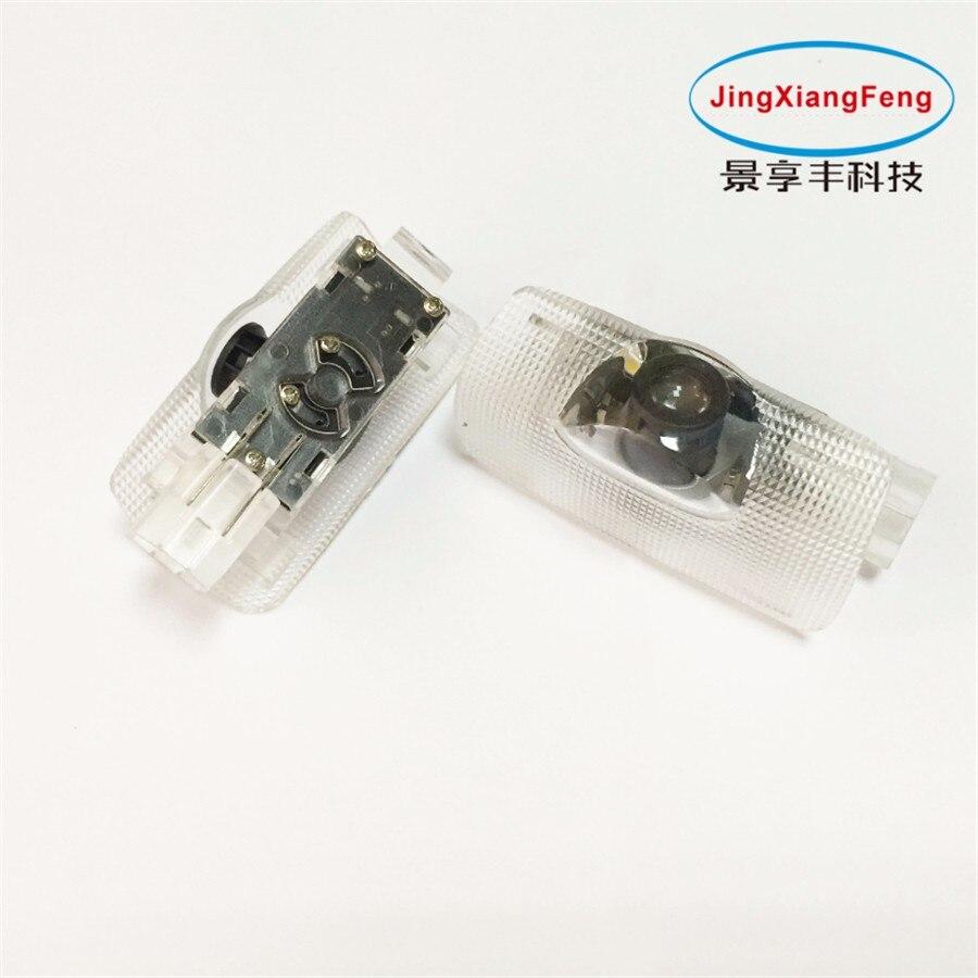 Carcasa de JingXiangFeng para TOYOTA, emblema LED, luz de bienvenida, lámpara de proyección de paso para puerta y suelo para secuoia/RAV4/Prius/Hilux/Camry