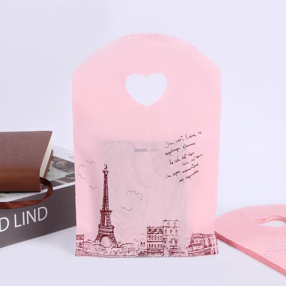50 pçs/lote Rosa Bonito Forma de Torre de Embalagem Sacos de Plástico Sacos de Compras Mini Presente Bolsa Sacos de Venda Quente Por Atacado