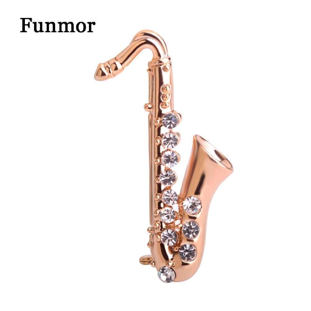 Broche Musical Pins forma de saxofón Broche de cristal Color dorado artista pequeño icono insignia traje bufanda Bijouterie niños sombrero Clips regalos