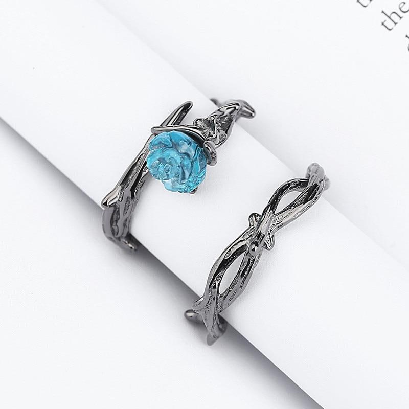 Crazy Feng nueva moda negro pistola rosa de color espinas diseño abierto anillo para mujeres dije de cristal azul dedo anillo accesorios de fiesta
