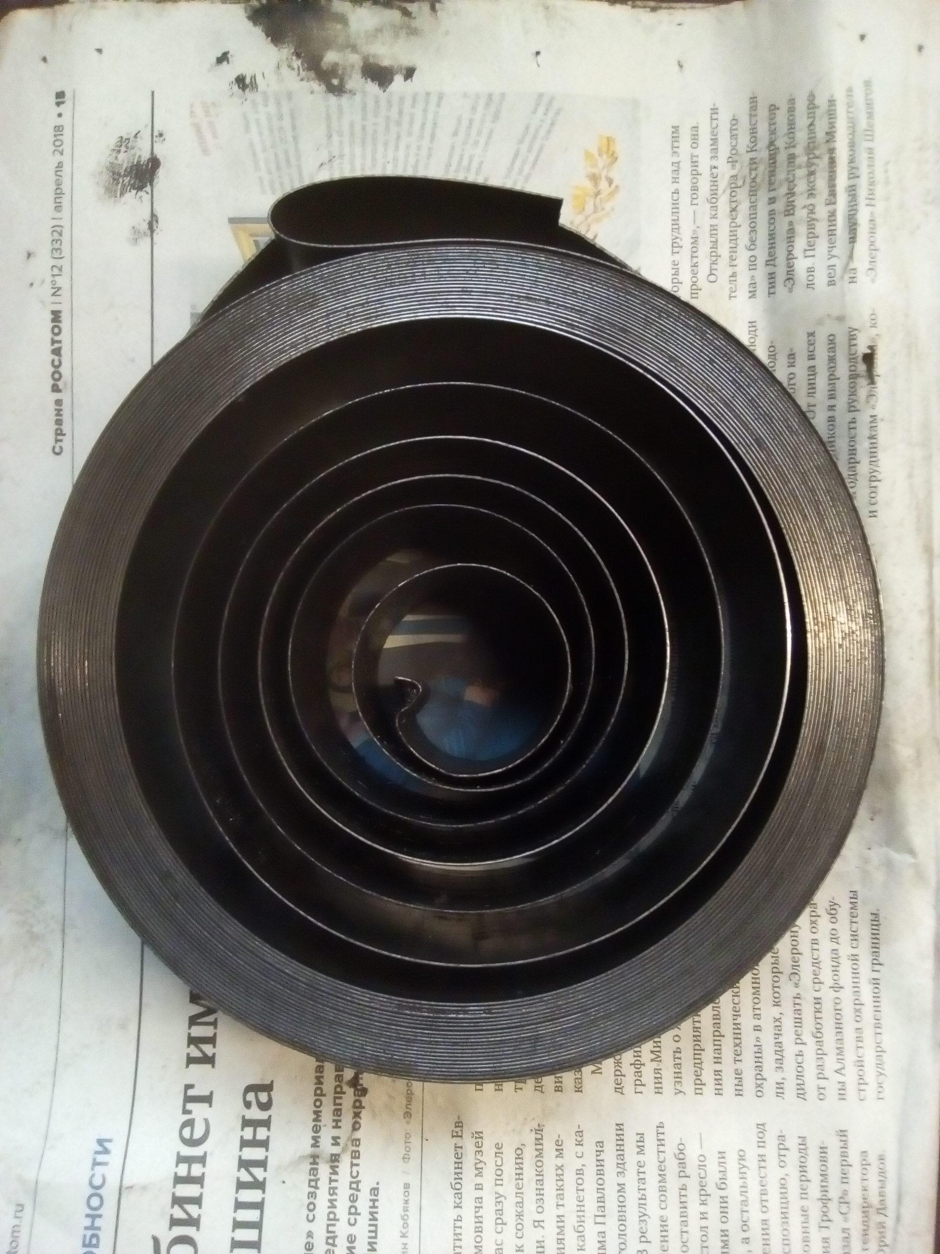 Dostosowane usługi ze stali sprężynowej sprężyny spiralne płaskie, z stałą siłę 0.5x40x145x10000mm