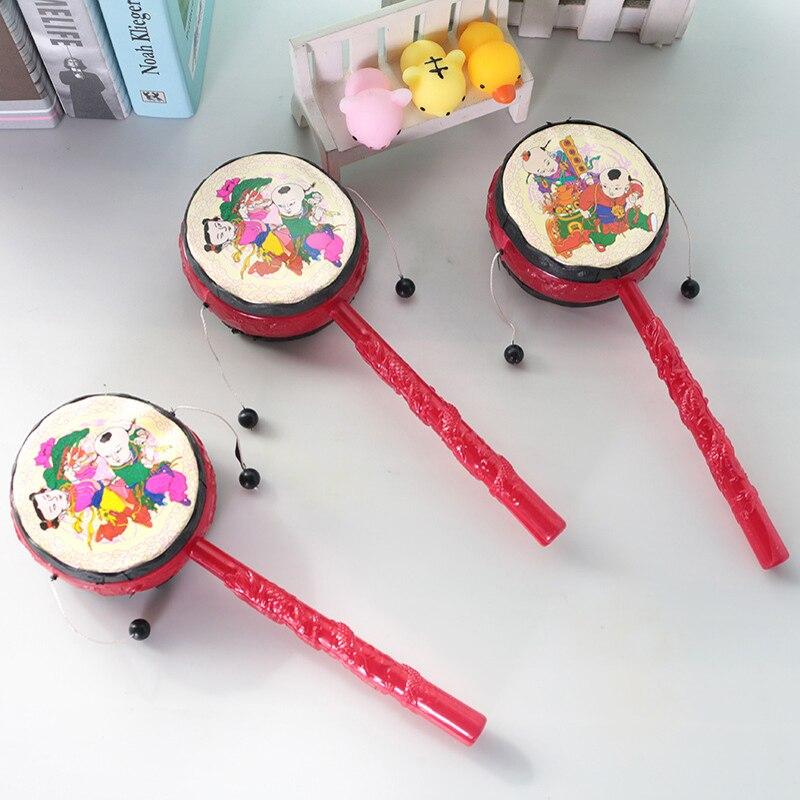 Tambor sonajero de dibujos animados para niños, Juguetes Divertidos chinos de plástico, juguete para regalo para recién nacidos 1 unidad