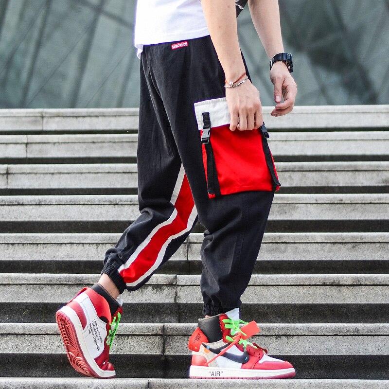Pantalones de estilo de calle americana a la moda para hombre, pantalones Cargo con bolsillos múltiples, pantalones de Hip Hop para hombre, pantalones de corredor de camuflaje negros empalmados