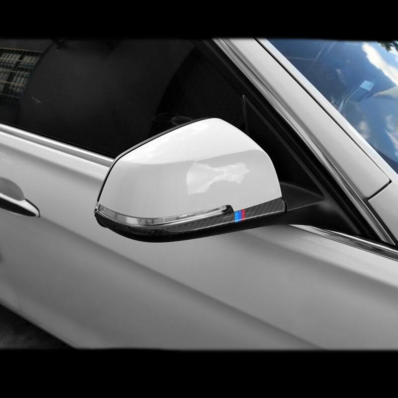 De fibra de carbono estilo de coche para cubierta de espejos retrovisores Trim tiras de la etiqueta engomada para BMW 1, 2, 3, 4 Series X1 F20 F30 F31 F34 E84 Accesorios