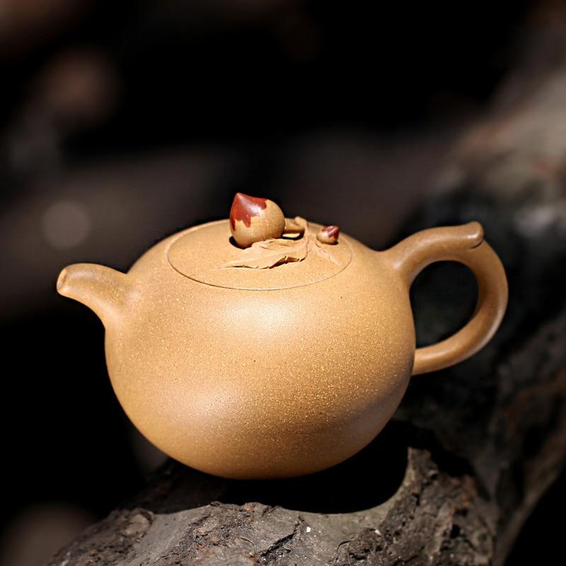Tetera de arcilla púrpura Yixing de 310ML, famosa tetera hecha a mano de Duan, mineral crudo Shoutao Puer, tetera de 188 agujeros, teteras Biluochun Tea Zisha