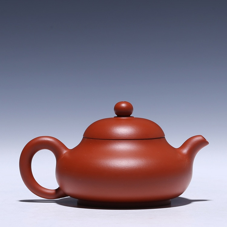 Yixing puro hecho a mano tetera Kung Fu té Zhu barro jade Bola de leche agujero de agua 170cc venta al por mayor