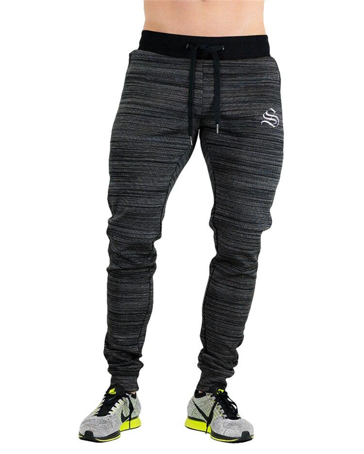 Otoño Invierno hombres corriendo Pantalones deportivos 2018 hombres Pantalones deportivos Jogging pantalones más de gran tamaño Rojo Negro elástico 2XL