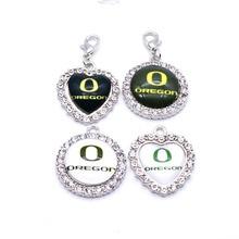 Balancent Charmes Université NCAA Oregon Ducks Charme Pendentif Fit Bracelets Colliers Bijoux Sport Basket-Ball 2018 De Mode